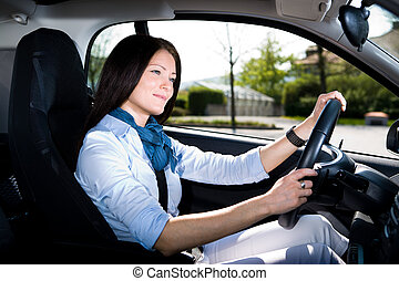 driving girl - a young woman driving the car