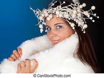Winter woman with christmas wreath