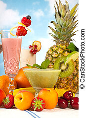 Summer smoothie party - Party table with summer fruits and...
