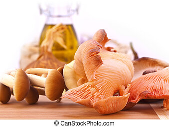 Fresh mushrooms on a wooden board - Stock Photo: Fresh...