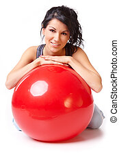 Woman with gym ball - Beautiful young woman with gym ball,...