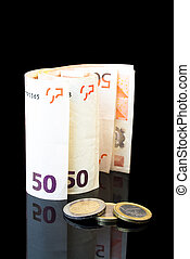 crisis eurozone - detail of money roll with euro coins on...
