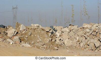 Dipper of excavator scoops stones
