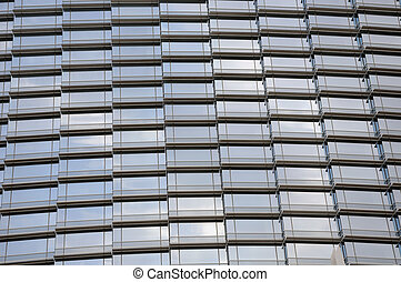 glass wall of skyscrapper with light reflection of sky