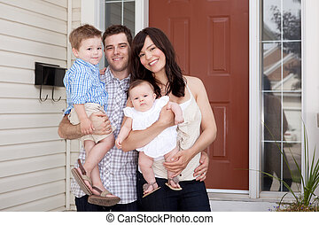 Family Portrait at Home - Portrait of a young family with...