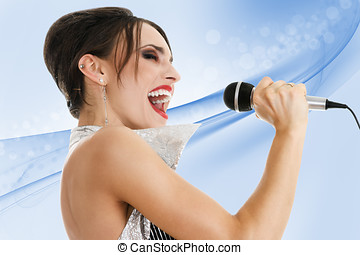 Beautiful singer with microphone against blue background