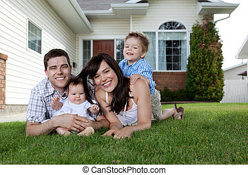 Young Parents with Children - Happy couple lying down on...