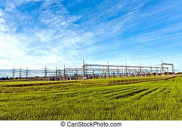 transformator station in green meadow