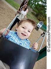Portrait of Small Boy Swinging - Close-up portrait of small...