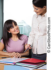 Women Discussing Business Issues - Professional female...