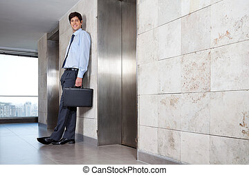 Handsome Corporate Manager Standing Near Lift