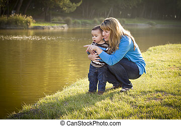 Happy Mother and Baby Son Looking Out At Lake