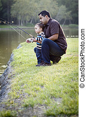 Happy Young Ethnic Father and Son Fishing