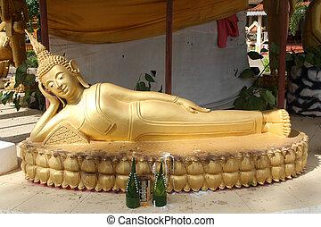 Sleeping Buddha - Big golden sleeping Buddha in monastery,...