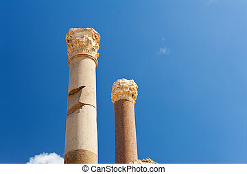 Two  pillars - Two ancient roman pillars against a blue sky