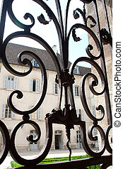 window with iron window grate in famous hospice in Beaune,...