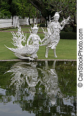 Wat Rong Khun near Chiang Rai - Two creatures near white...