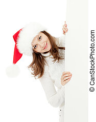 happy young woman in Christmas Santa's hat holding big banner for your advertisement isolated on white