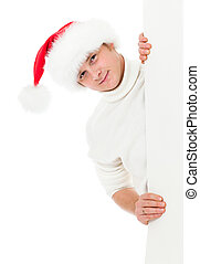 happy young man in Christmas Santa's hat holding big banner for your advertisement isolated on white
