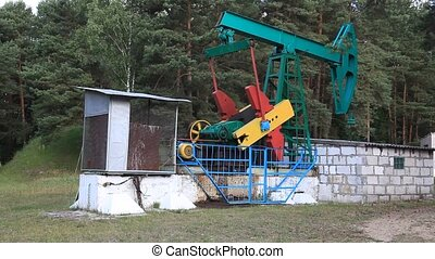 oil pump - An oil pump jack on a wood background