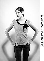 beautiful woman with jeans in black and white hight contrast on white background