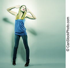 beautiful fashion woman posing in green light