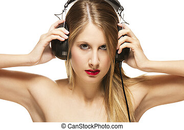 beautiful woman with headphones spreading her arms on white background