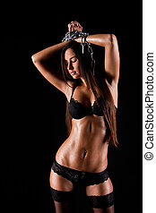Young beautiful girl naked isolated on a black background