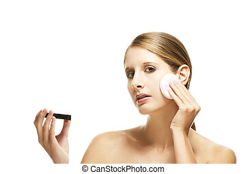 beautiful woman applying makeup on white background