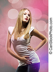 young beautiful blonde woman posing in colorful light