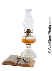 Oil Lamp and Bible Isolated - A pair of glasses resting on...