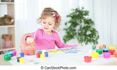 Child painting colors