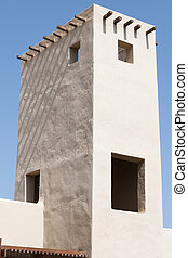 White tower - White arab tower with crossed wood pillars
