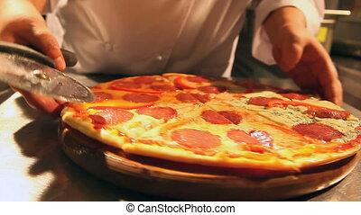 Chef cuts pizza