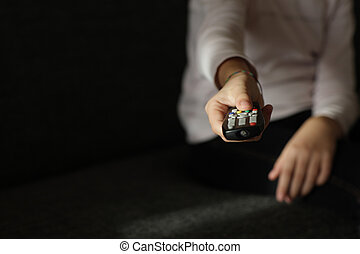 Child's hand, with remote control