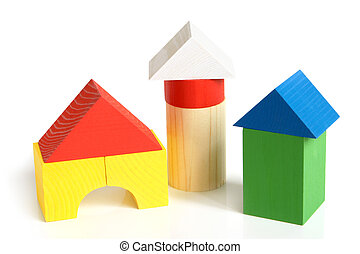 House made from childrens wooden building blocks on a white...