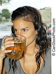 Young woman drinking beer - Beautiful young woman drinking...