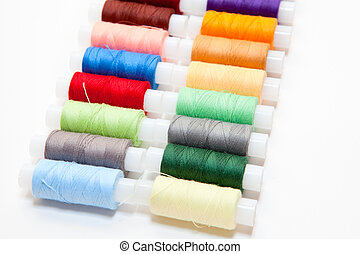 Colourful arranged reel of thread isolated on a white background.