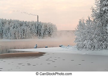 Unfrozen lake in the winter forests Wastewater from sewage...