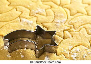 Cutting out Christmas cookies from shortcrust dough with a...