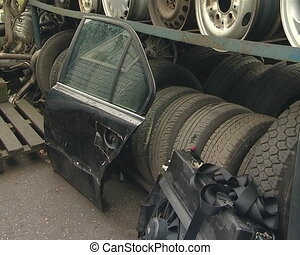 Automobile parts in dump. Wheels and other used parts.