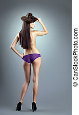 Sexy woman in purple panties and hair style