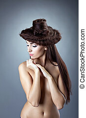 Bare woman with hair style close breast confused