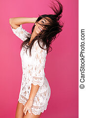 Model In Lacy Garment Flicking Hair - Playful young model in...