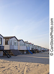 Little houses on beach in The Netherlands