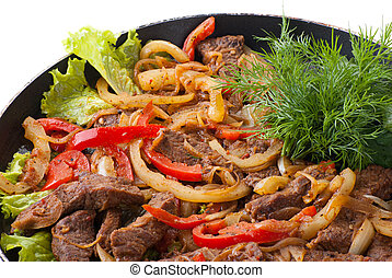 traditional mexican beef fajitas on white background