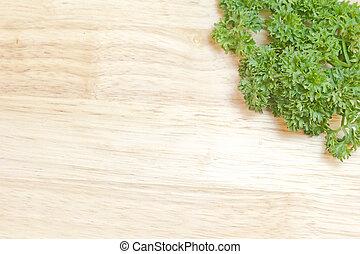 fresh parsley on a cutting board - fresh sprig of parsley on...
