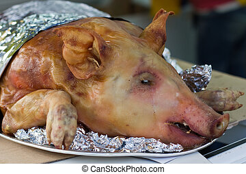 Dead pig ready to be cooked - A dead pig on a market in...