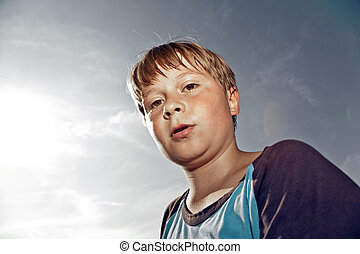 boy with sweating face after sport looks confident