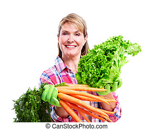 Senior woman with vegetables.